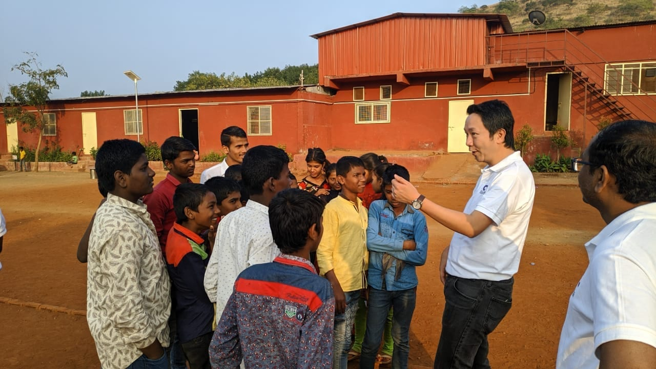 Co-founder Erik Leung teaches kids at orphanage in India